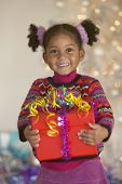 Young African American girl holding gift
