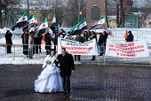 Newly Married Couple And Syrian Protesters