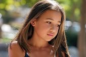 stock photo of teenage girl  - beautiful teenage girl on a sunny day - JPG