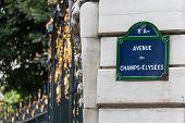 Champs Elysees Street Sign On A Pillar