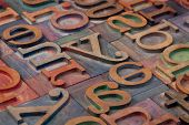 abstract of vintage wooden letterpress printing blocks stained by color inks