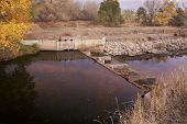 diversion dam with water flowing into irrigation ditch inlet, Cache la Poudre River at Fort Collins,