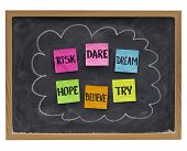 motivational concept (hope, believe, dare, risk, try,dream) - sticky notes on blackboard