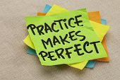 practice makes perfect - a motivational slogan on a green stocky note