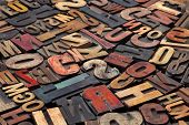 antique wood letterpress printing blocks with color ink patina, random collection of different size