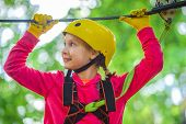 Portrait Of A Beautiful Kid On A Rope Park Among Trees. Happy Child In Summer. Roping Park. Rope Par poster