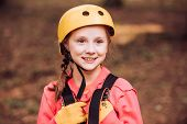 Little Child Climbing In Adventure Activity Park With Helmet And Safety Equipment. Happy Child Climb poster
