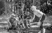 Company Friends Having Hike Picnic Nature Background. Summer Picnic. Hikers Relaxing During Snack Ti poster