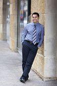 Hispanic Businessman - Leaning On Stone Wall
