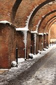 Romanic style archway in wintertime