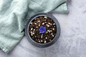 Wild Black Rice With A Lactose-free Feta Cheese And An Edible Flower, A Blue Cornflower, Shot From T poster