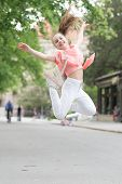 Bouncy And Energetic. Energetic Little Child In Motion On City Street. Lively Small Girl Jumping Wit poster