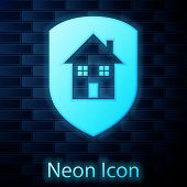 Glowing Neon House Under Protection Icon Isolated On Brick Wall Background. Home And Shield. Protect poster