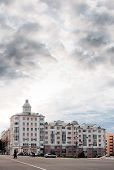 Residental House And Cloudy Sky