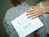 Guy being unaware of a �¢�?�?Kick me�¢�?� sign attached to his back