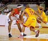 KUALA LUMPUR - FEBRUARY 19: Singapore Slingers' Donald Dulay (11) takes on Dragons Guganeswaran (0) at the ASEAN Basketball League match on February 19, 2012 in Kuala Lumpur. Dragons won 86-71.