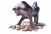 A Strong, Triumphant Bull Atop A Pile Of Coins, Signifying An Optimistic Or Bullish Foreign Currency