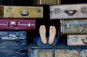 Feet Protruding From Suitcases
