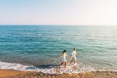 Couple In Love Having Fun On The Beach. Honeymoon Trip. The Couple Are Traveling. Man And Woman On T poster