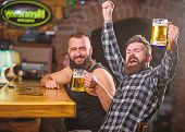 Refreshing Beer Concept. Hipster Brutal Man Drinking Beer With Friend At Bar Counter. Men Drunk Rela poster