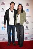 LOS ANGELES - FEB 19:  Robbie Amell; Italia Ricci arrives at the 2nd Annual Hollywood Rush at the Wi