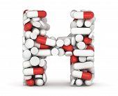 Letter h alphabet of medicine pills on white background