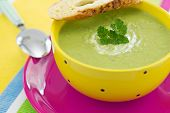 Pea Cream Soup With Parsley And Croutons, On Pink Plate