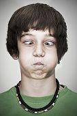 cross-eyed young teenager boy