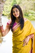 image of traditional dress  - portrait of a beautiful young indian woman in the garden - JPG
