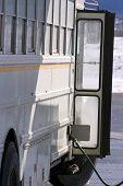 foto of high-octane  - white school bus pumping gas - JPG