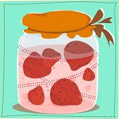 jar with jam and strawberries in it