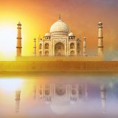 Taj Mahal India Sunset. Agra, Uttar Pradesh. Beautiful Palace with reflection in river. Wonderful la