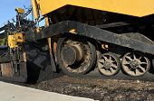 Wheels Of An Asphalt Paving Machine On New Road