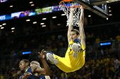 BROOKLYN-DEC 15: Michigan Wolverines guard Nik Stauskas (11) dunks against the West Virginia Mountai