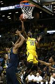 BROOKLYN-DEC 15: Michigan Wolverines guard Tim Hardaway Jr. (10) shoots against the West Virginia Mo
