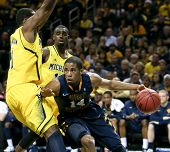 BROOKLYN-DEC 15: West Virginia Mountaineers guard Gary Browne (14) drives past Michigan Wolverines f