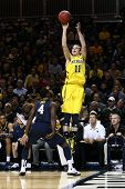 BROOKLYN-DEC 15: Michigan Wolverines guard Nik Stauskas (11) shoots over West Virginia Mountaineers