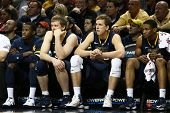 BROOKLYN-DEC 15: West Virginia Mountaineers players react on the bench against the Michigan Wolverin