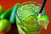 cold fresh lemonade drink with cucumber and lime