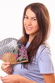 Happy Young Woman With A Fan