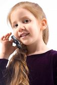 Young Girl With Talking On Cell Phone And Smiling