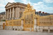 stock photo of versaille  - golden gate of palace versailles paris france - JPG