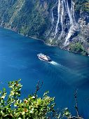 A View Of A Norwegian Fiord And Its Waterfalls.