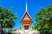 stock photo of crematory  - The buddhist crematory in Thai temple with blue sky background - JPG