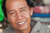 BALI - FEBRUARY 13. Portrait of fisherman on Jimberan beach on February 13, 2012 in Bali, Indonesia.