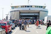 SPLIT, CROATIA - AUGUST 4, 2012: People boarding the ferry on August 4, 2012 in Split, Croatia. Split is the second-largest city of Croatia.
