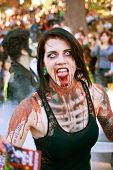 Female Zombie Makes Scary Face In Halloween Parade