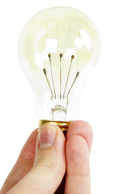 foto of thinking outside box  - a hand holding an old fashioned light bulb - JPG