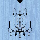 silhouette of luxury chandelier on a scratched blue wallpaper/ template design of invitation