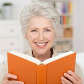 Attractive Senior Woman Reading A Book